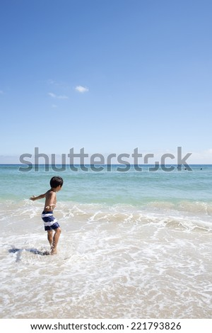 Boy playing in the sea #221793826