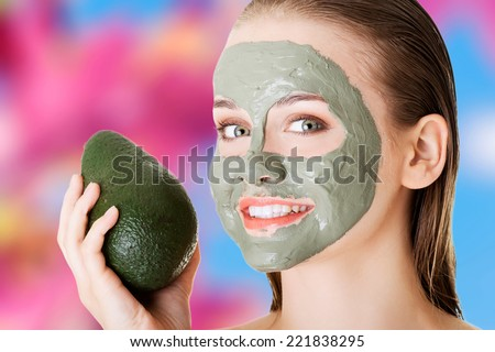 Beautiful spa woman in facial mask and avocado #221838295