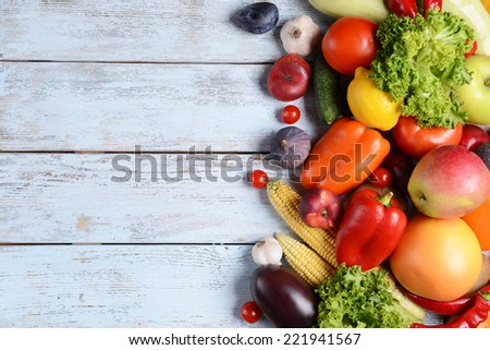 Fresh organic fruits and vegetables on wooden background #221941567