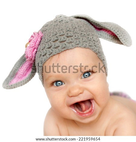 Portrait of smiling baby in the hat like a bunny or lamb. Isolated on white background #221959654