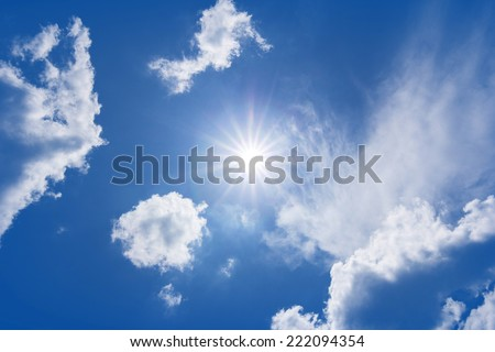The sun shines bright in the daytime in summer. Blue sky and clouds. #222094354