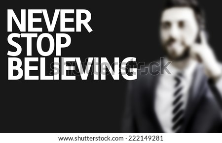 Business man with the text Never Stop Believing in a concept image #222149281