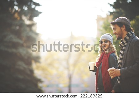 Young people walking in autumn Royalty-Free Stock Photo #222189325