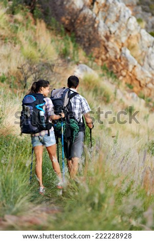 Couple walking along a hiking path #222228928