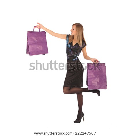 young pretty woman standing with colorfool shopping bags, studio #222249589