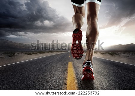 Sports background. Runner feet running on road closeup on shoe.  #222253792