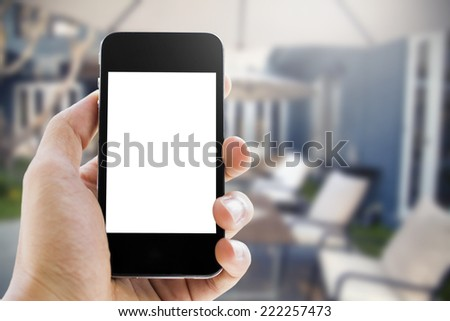 hand holding phone on outdoor background #222257473