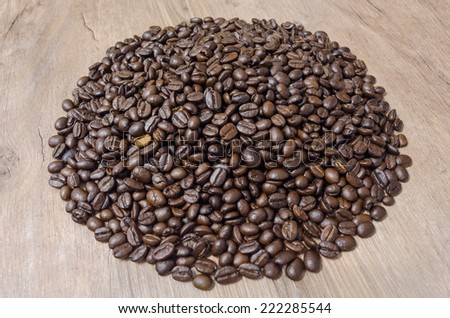 Coffee beans on wooden background. #222285544