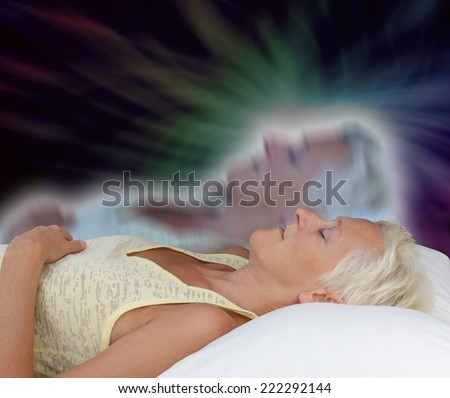 Female lying supine with eyes closed experiencing astral projection on dark background showing astral body rising up Royalty-Free Stock Photo #222292144