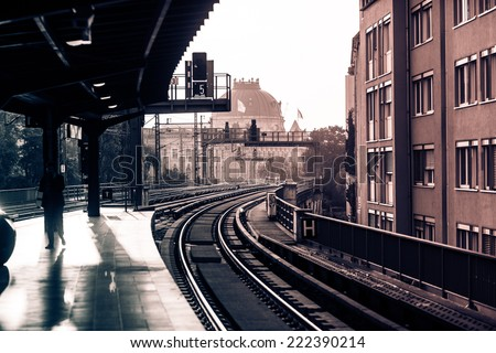 Vintage train station with railway lines in Berlin. Retro filtered. Monochrome cream tone. Black and white photography.