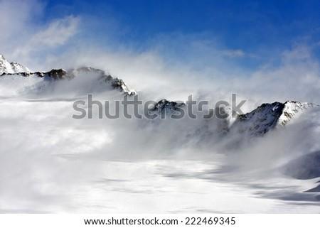 windy mountain range in Alps #222469345