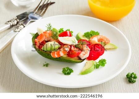Avocado salad with shrimp and quail eggs. #222546196