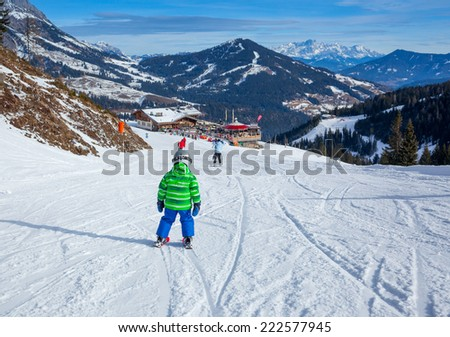 Ski, skier, winter - back view of lovely small boy has a fun on ski #222577945