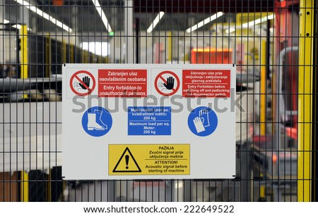 sign with safety notices in factory