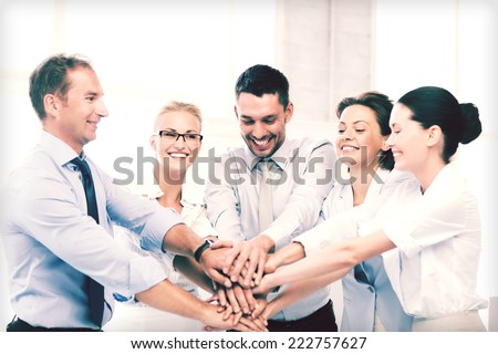 picture of happy business team celebrating victory in office #222757627