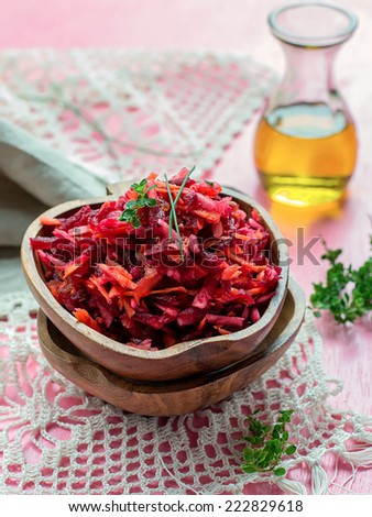 Fresh salad with beetroot, carrots and apples on pink background #222829618