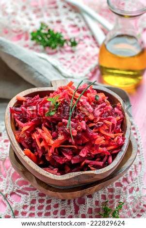 Fresh salad with beetroot, carrots and apples on pink background #222829624