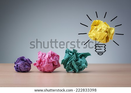 Inspiration concept crumpled paper light bulb metaphor for good idea Royalty-Free Stock Photo #222833398
