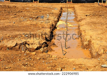 Concrete foundations with reinforcing bars and mud #222906985