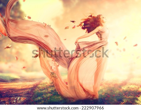 Beauty Autumn Woman, beautiful fantasy girl, fairy in blowing transparent chiffon dress. Fall. Fashion model lady in windy autumn park Royalty-Free Stock Photo #222907966
