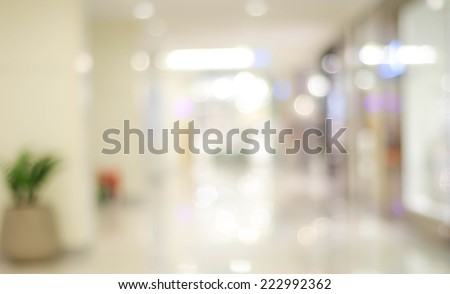 Blur light background at shop in mall for business background, blurry abstract bokeh at interior hallway Royalty-Free Stock Photo #222992362