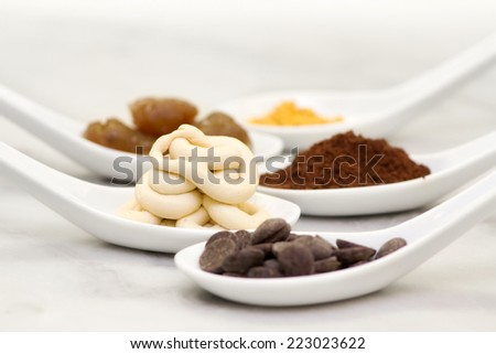 sweets ingredients, cream stuffing and chocolate for confectionery recipe #223023622