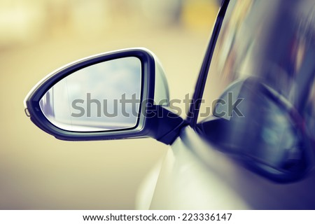 side rear-view mirror on a modern car #223336147