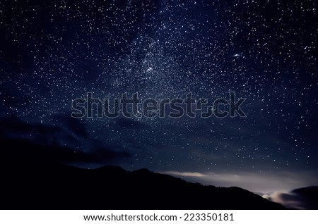 Night sky with lot of shiny stars, natural astro background Royalty-Free Stock Photo #223350181
