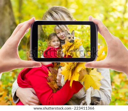 family photographed in the autumn forest
