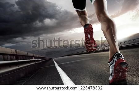 Sport. Runner feet running on road closeup on shoe. #223478332