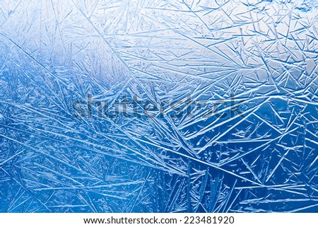 Ice flowers frozen window macro view. Frost textured pattern. cold winter weather xmas background concept #223481920