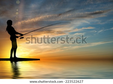 Silhouette of teenager girl fishing at sunset #223522627