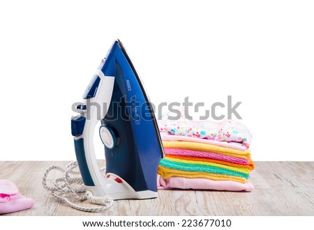 children's clothing and a steam iron on a light background #223677010