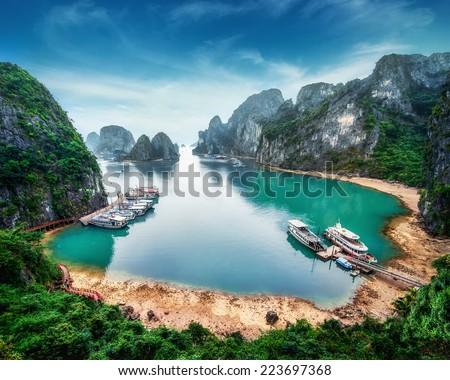 Tourist junks floating among limestone rocks at Ha Long Bay, South China Sea, Vietnam, Southeast Asia Royalty-Free Stock Photo #223697368