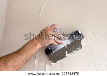 The process of applying the second layer of putty trowel for light plaster walls #223713475