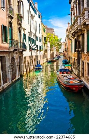 blue and green water of a venetian canal, Italy #22374685