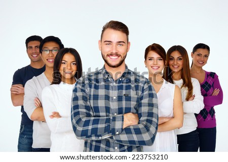 Portrait of happy young casual people with arms folded over white background