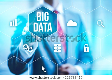 Big data concept man selecting and pressing Big Data symbol Royalty-Free Stock Photo #223785412