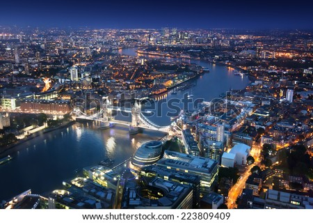 London at night with urban architectures and Tower Bridge Royalty-Free Stock Photo #223809409