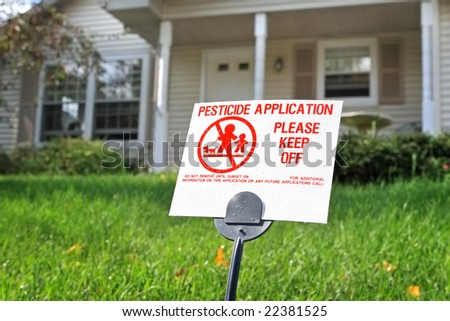 Pesticide application sign on a residential lawn