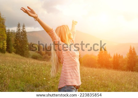 Happiness woman stay outdoor under sunlight of sunset Royalty-Free Stock Photo #223835854