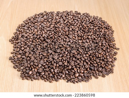 Coffee beans on wooden background. #223860598