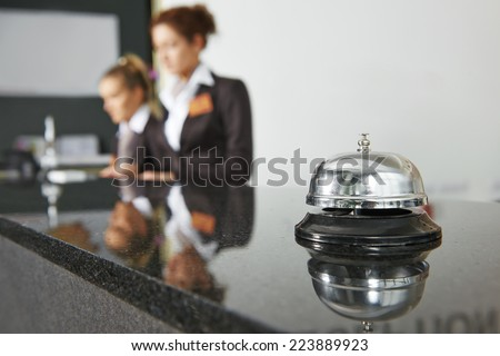 Modern luxury hotel reception counter desk with bell Royalty-Free Stock Photo #223889923
