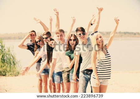Beautiful young people on beach #223896739