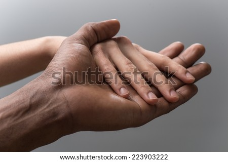 Friendship and love concept between man and woman. man's hand hold by girl hand isolated on grey background  #223903222