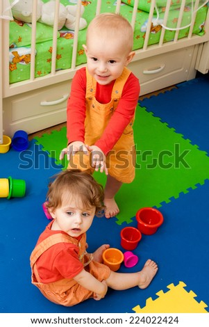 baby plays in a nursery #224022424
