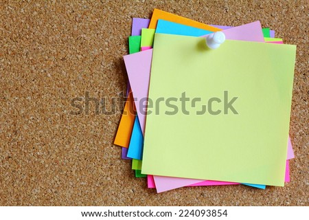 colorful sticky notes on cork bulletin board Royalty-Free Stock Photo #224093854
