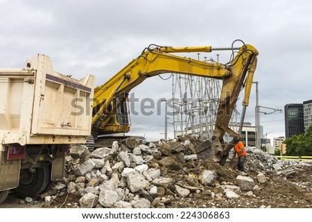 excavator placing sand or debris on a truck in Barcelona #224306863