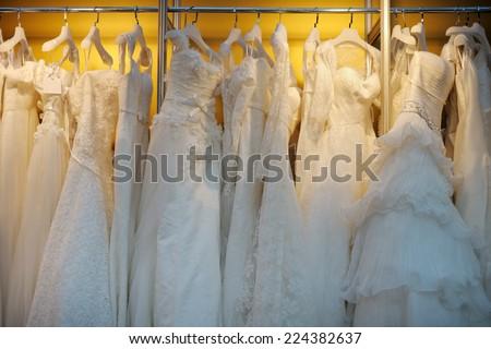 A few beautiful wedding dresses on a hanger  #224382637