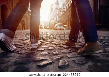 tourist couple walking on cobblestone street vacation in europe on holiday break #224435719